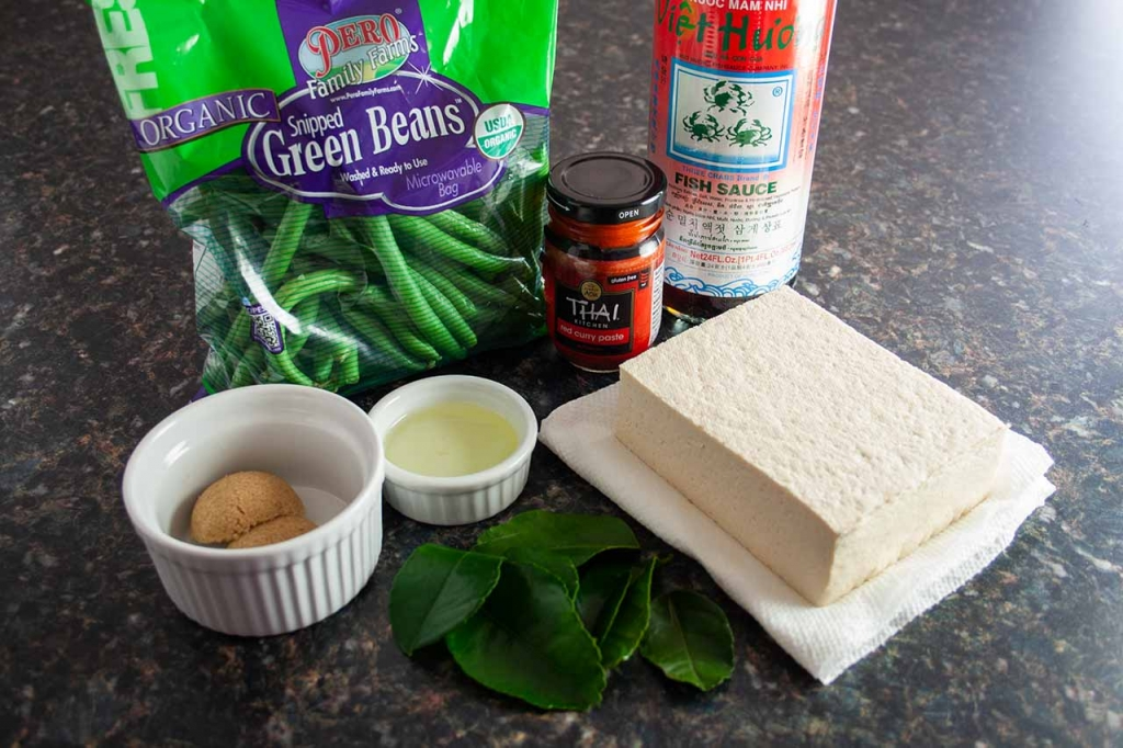 Just seven ingredients: green beans, red curry paste, fish sauce, extra firm tofu, vegetable oil, brown sugar, and Kaffir lime leaves.