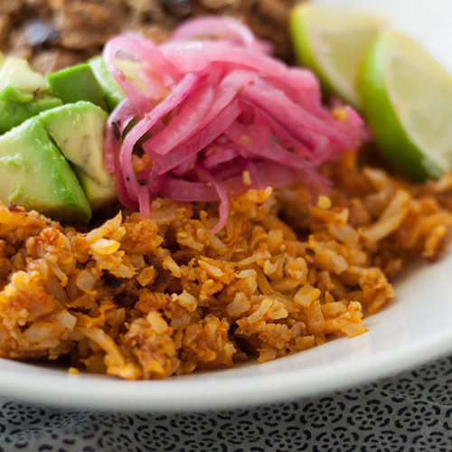 plate of Mexican Cauliflower Rice with Pressure Cooker Pork Carnitas