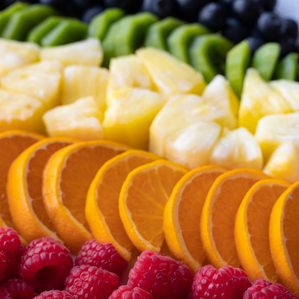 fruits arranged in a rainbow